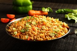 Asian cuisine-Homemade egg fried rice served with vegetables,