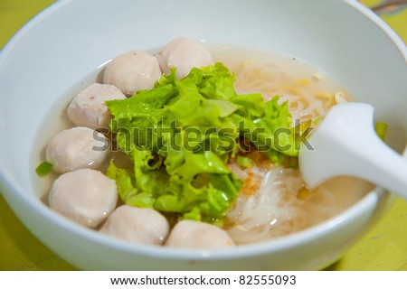 Asian cuisine, rice noodles with fish ball and meat ball - stock photo