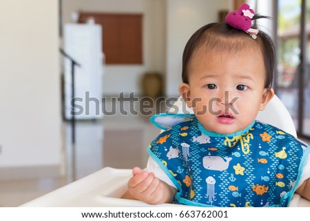 Asian cute baby standby on chair kid for feeding time. #663762001