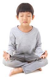 Asian cute boy sitting while meditation.Yoga boy. Child in the lotus position.Children meditation and relax. Boy sitting on floor meditating. Yoga. Lotus Position. ISOLATED. Cute Yoga Boy. Yoga Kid.