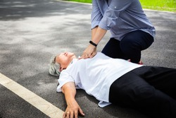 Asian daughter first aid emergency CPR on unconscious senior mother,caregiver try to resuscitation patient,after accident,heart attack,shock,elderly woman with cardiac arrest while exercise in park