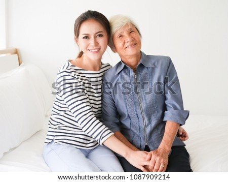 asian daugther with mother...