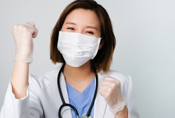 asian doctor wear the medical mask to protect and fight infection from germ, bacteria, covid19, corona , sars , influenza virus on white background with the happy face.