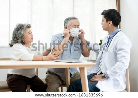 Asian elderly couples are sick doctor to check their symptoms at home. Health care , elder insurance after retire concept.