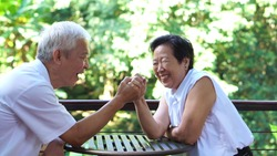 Asian elderly old couple compromising in game of love secret of lasting love
