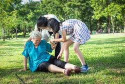 Asian elderly people with walker on floor after falling down,caring woman assistant,sick senior mother fell to the floor because of dizziness,faint,daughter,granddaughter to help and take care of her