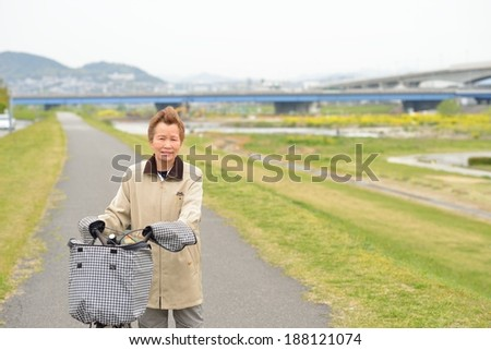 Asian elderly woman you are riding a bicycle