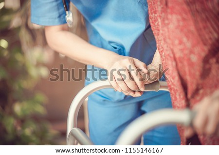 Asian eldery  woman with her caregiver at home. Home care or Elderly care concept. - Shutterstock ID 1155146167