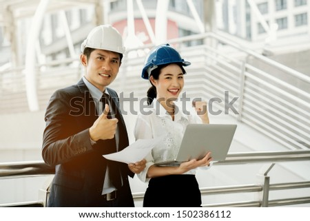 Asian engineer chief consult with secretary. Quality engineers or construction teamwork. Safety concern for engineering or building work site or plant. Wearing helmet and protective equipment can safe #1502386112