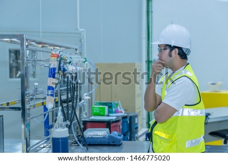 Asian engineer working at Operating hall,Thailand people wear helmet  work,He worked with diligence and patience #1466775020