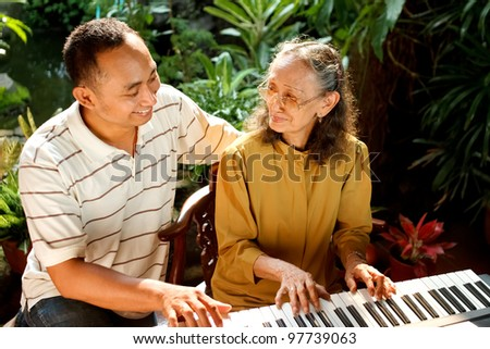 stock photo asian ethnic family portrait of elderly mother play piano together with young adult son 97739063 9 images Blonde Bbw Model Fiona Steels Poses In Lingerie And Exposes Her Big ...