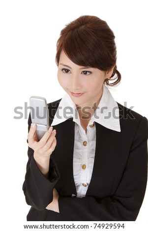 Asian executive woman looking message of sms on cellphone and smiling, half length closeup portrait on white background.