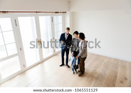 Asian family buy new house #1065551129