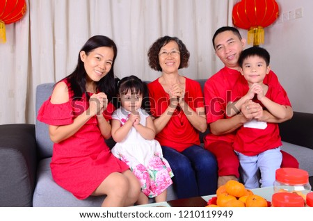 asian family celebrate chinese new year 1210119949
