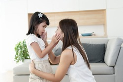 Asian family consoling together, mother and kids or little girl touch cheek and talking about soothe sad problem topic