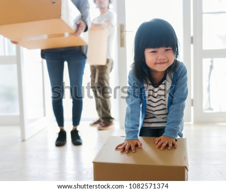 Asian family emoving to new house