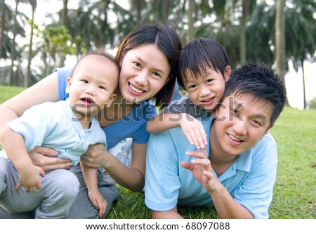 asian family enjoying outdoor fun