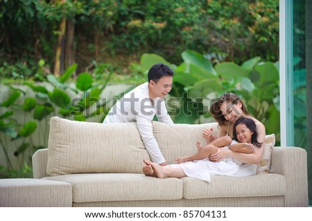 Asian Family enjoying time together in the living room
