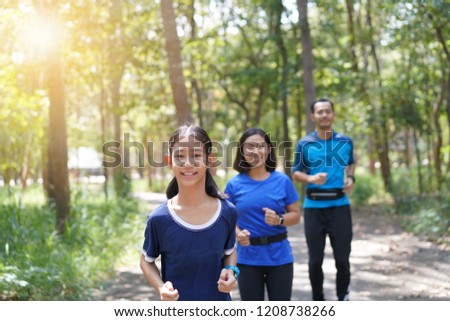 Asian family exercising and jogging together at the park #1208738266