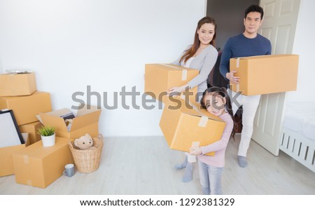 Asian family father mother daughter carry cardboard box move to new house, online marketing hand holding unpack stuff belongings home delivery. Lifestyle happy asian family together relocation concept