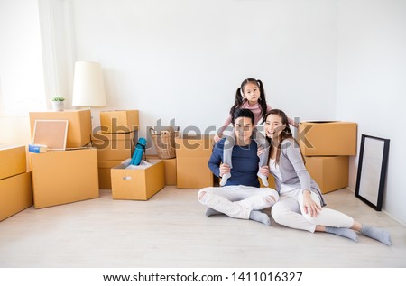 Asian family father mother daughter girl packing cardboard box move to new house, online marketing unpack stuff belongings home delivery. Lifestyle happy asian family together relocation concept.