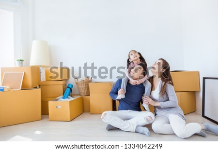 Asian family father mother daughter girl packing cardboard box moving to new house, online marketing e-commerce unpacking stuff home delivery. Lifestyle happy asian family together relocation concept.