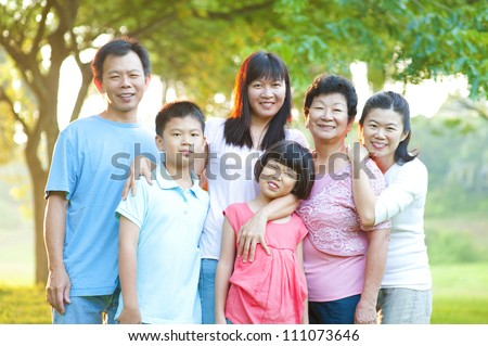 Asian family having a great time at outdoor park