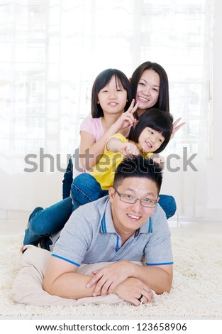 asian family having fun time at home