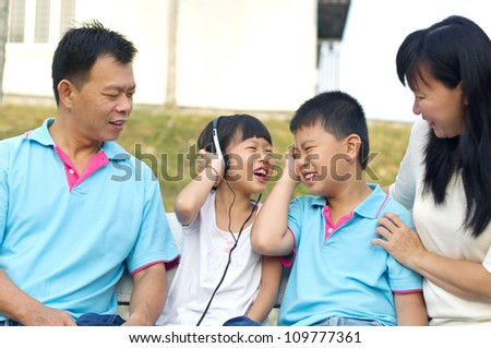 asian family having fun time at outdoor - stock photo