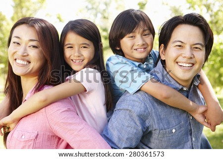 Asian family head and shoulders portrait outdoors #280361573