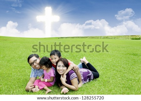 Asian family is celebrating Easter by playing in a park