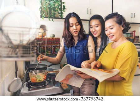 Asian family is cooking in the kitchen together