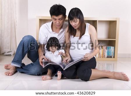 asian family learning in living room