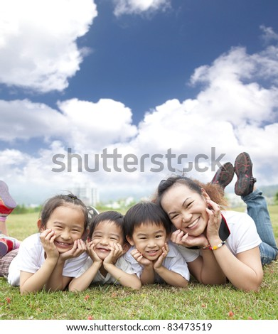 asian family on the grass with cloud background