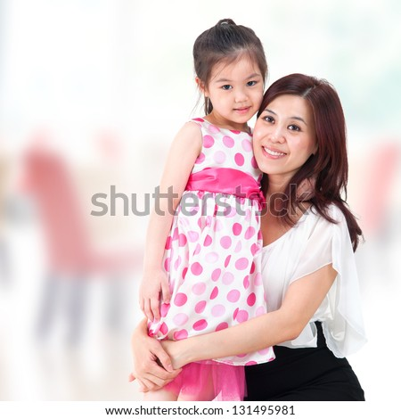 Asian family parent and child. Mother and daughter at home.