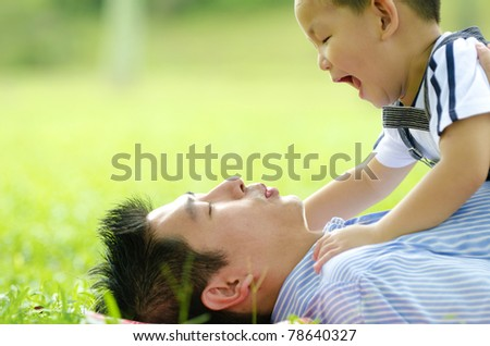 asian family playing on outdoor - stock photo
