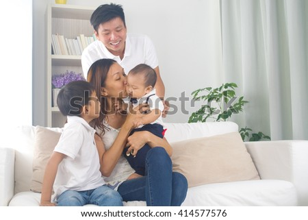 Asian family playing with baby