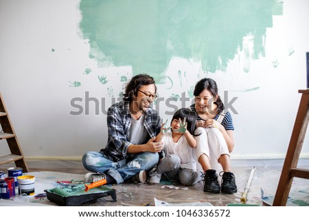 Asian family renovating the house