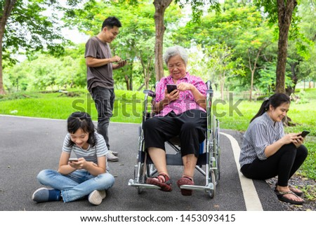 Asian family,senior grandmother,father,mother,daughter with internet,mobile phone addict,child girl playing video game,parent addicted cellphone,social problem in family relationship,addiction concept #1453093415
