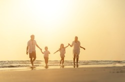 Asian family vacation at the beach with family relationships caused love and understanding to strengthen social immunity. Happy vacations holiday asian people.