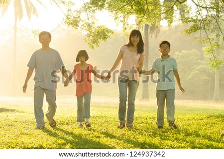 asian family walking in the park