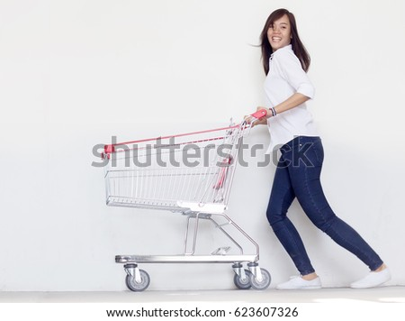 asian fashionist teen girl have funny action with shopping cart in love shopaholic concept #623607326
