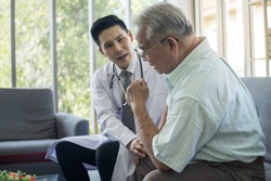Asian Fat old man meets a doctor at clinic. A white-haired senior man consulting doctor about health at nursing home. Retired male medical consultation By specialist psychiatrist At mental hospital