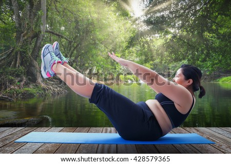 asian fat woman take v shape six pack course in the morning on wooden platform outdoor Photo stock ©