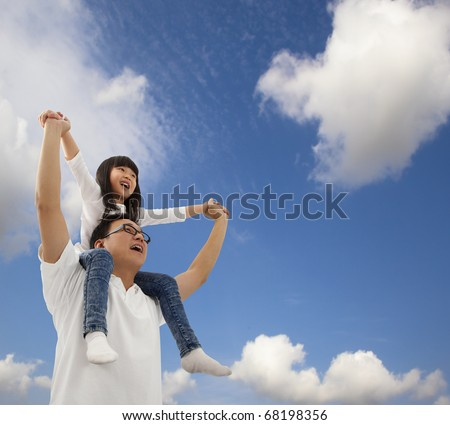 Asian father and daughter under blue sky