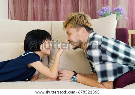 Asian father and his cute little girl #678521365