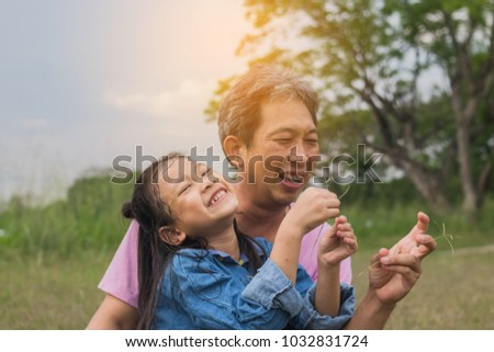Asian father and little cute daughter playing together in park, #1032831724