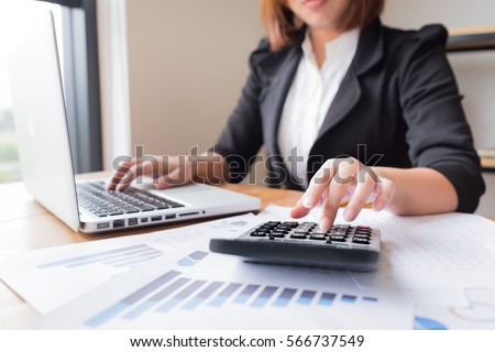Asian female accountant or banker making calculations. Savings, finances and economy concept. Foto d'archivio ©