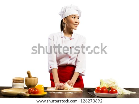 Asian female chef cooking pizza dough, isolated on white background