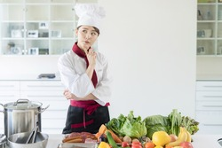 Asian female chef in kitchen. Cooking. Restaurant.